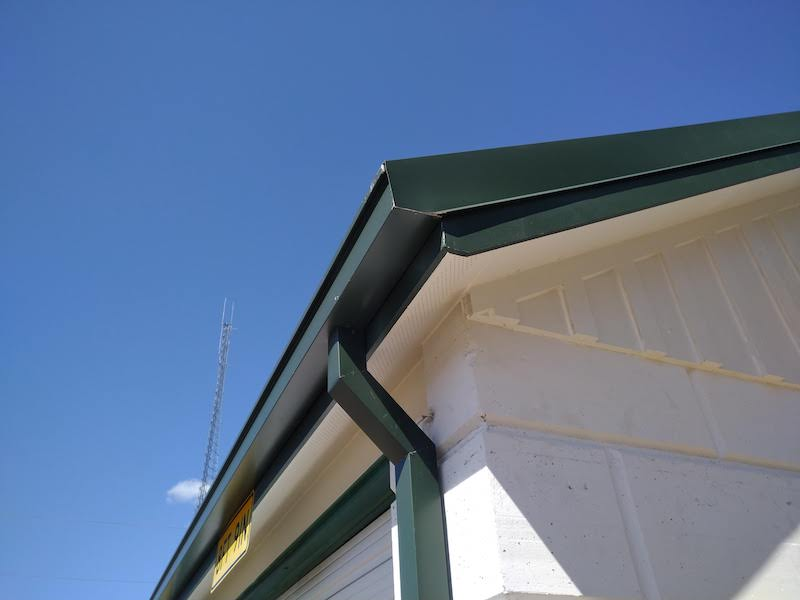 Green gutter replacement on mini storage unit in Sulphur Springs Texas
