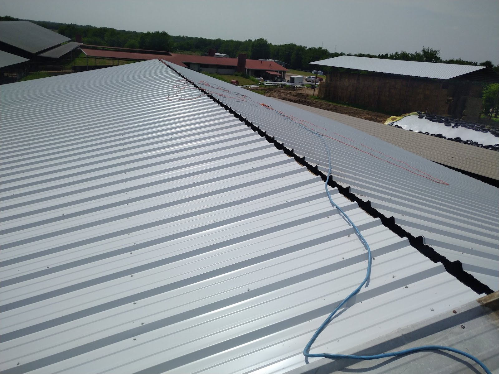 Metal farm commercial roof in Sulphur Springs after replacement