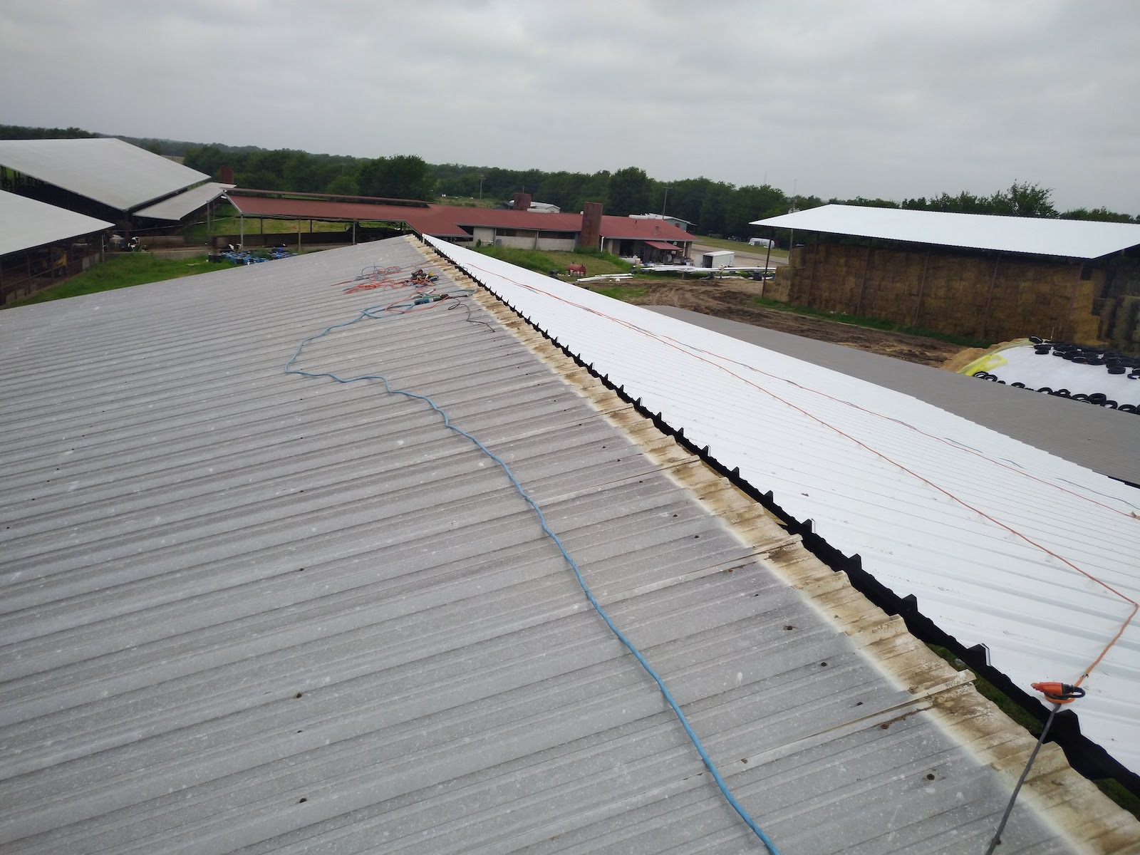 Metal farm commercial roof in Sulphur Springs before replacement