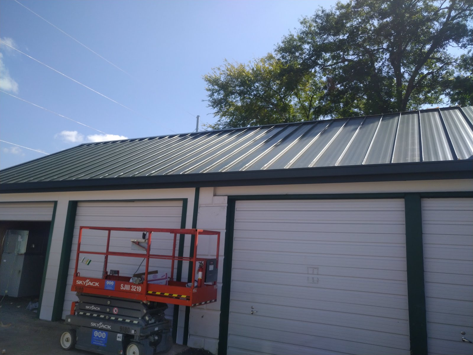 choice one restoration staff installing metal commercial roof