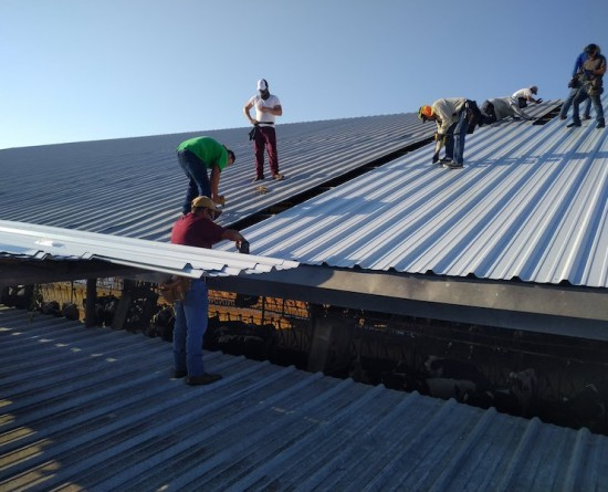 Choice One Restoration team on commercial roof